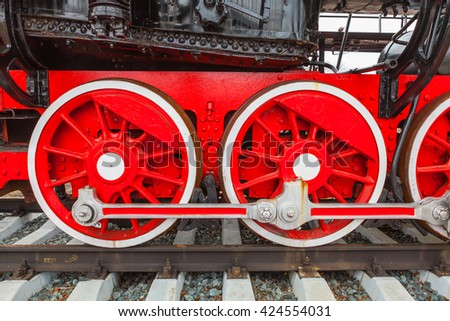 The close-up wheels of the old steam train - stock photo