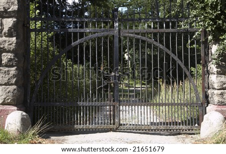 The closed gate of old lock - stock photo
