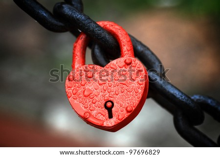 The closed red padlock in the form of heart - stock photo