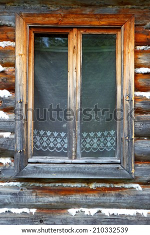 The closed window of the old wooden house - stock photo