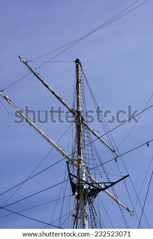 The closeup of a sailboat mast against a blue sky / Sailboat mast   - stock photo