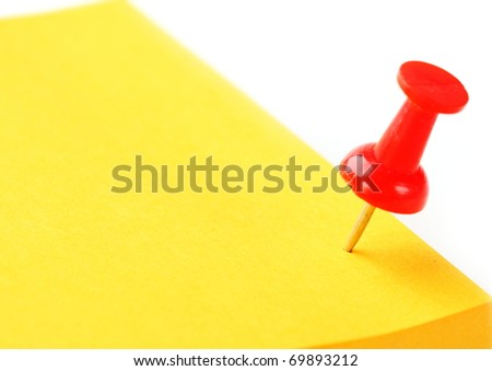 The closeup of empty yellow note and office pin - stock photo