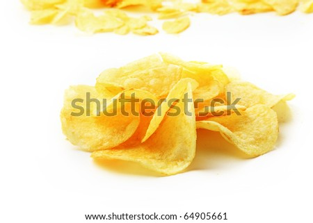 The closeup of many yellow chips isolated on white