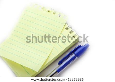 The closeup of notepad on white background - stock photo
