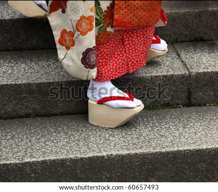 The closeup of the traditional okobo wooden sandals of a Japanese Maiko (Geisha in training). Kyoto Japan - stock photo
