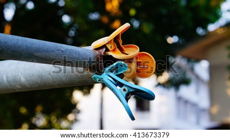 The clothespin - stock photo