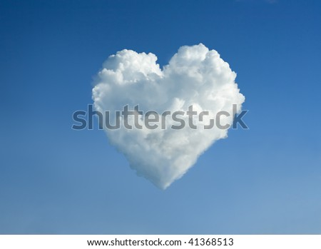 The cloud in the form of heart against a blue sky. To the Valentine's Day joke. - stock photo