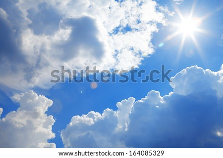 The clouds and sun on a background of blue sky - stock photo