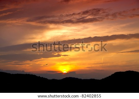 the clouds are hiding behind the mountains - stock photo