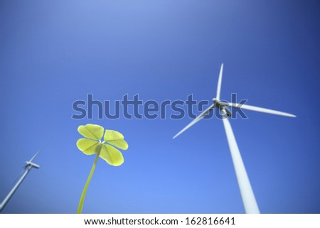 The clover and windmill of four leaves - stock photo
