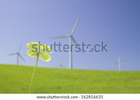 The clover, windmill, and prairie of four leaves - stock photo