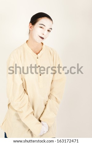 The clown is standing in front of a camera and making a face - stock photo