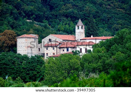 The cluniac monastery of San Pietro in Lamosa, in Provaglio d'Iseo - Brescia, Italy emerges from the lush vegetation. Built in 1083