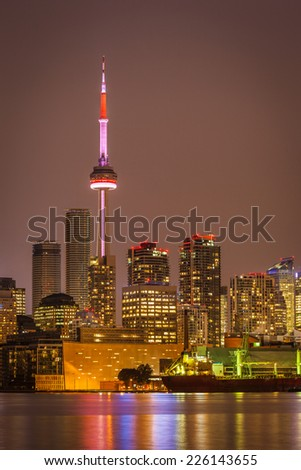 The CN Tower, the icon of Toronto, at night - stock photo