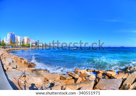 The coast line of Limassol, Cyprus on a sunny day on the background of a clear blue sky through fisheye lens in HDR - stock photo