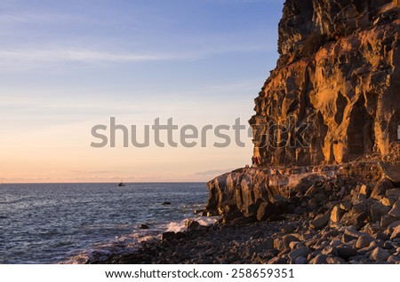 The coast of Atlantic ocean on sunset, Gran Canaria, Canary islands, Spain - stock photo