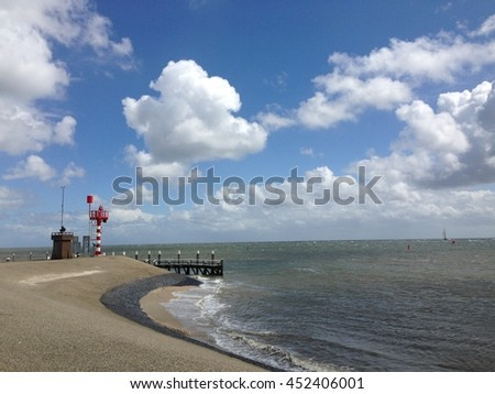 The coast of Texel with a dike in The Netherlands - stock photo