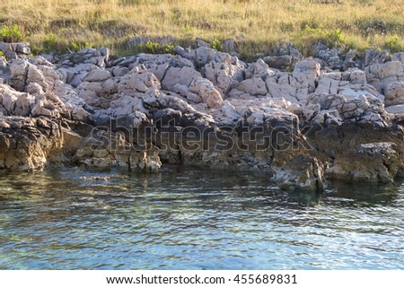 The coast of the island at Adriatic sea by National Park Kornati in Croatia at Adriatic sea, Mediterranean, Europe - stock photo