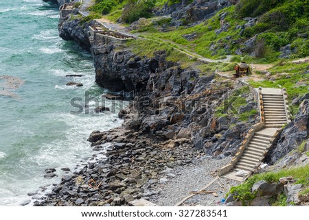 The coastal path and rock climbing stairs - stock photo