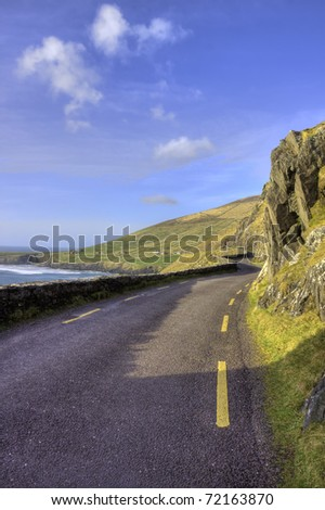 The coastal road leading to the dingle in ireland. - stock photo