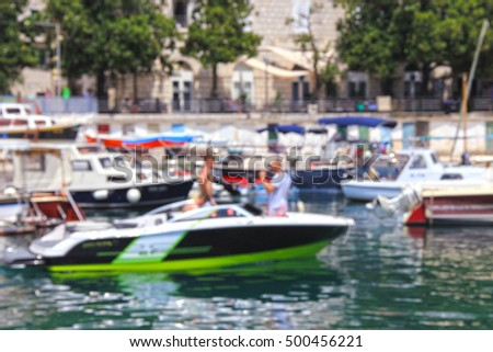 The coastline and quay for boats, luxury yachts, pleasure boats, blurred for background