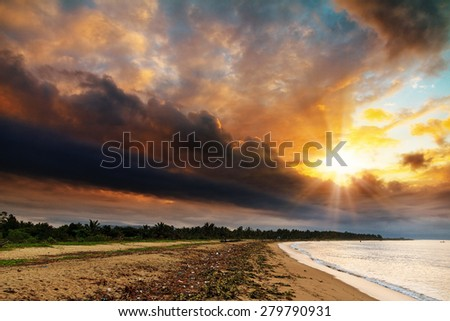 The coastline of Maroantsetra in Madagascar at sunrise, with a dramatic sky - stock photo