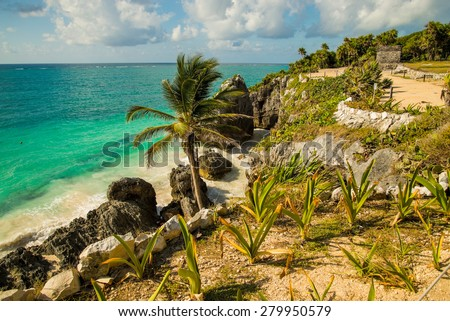 The coastline of the ancient Mayan ruins in Tulum, Mexico on a beautiful blue sky day - stock photo