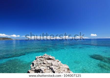 The cobalt blue sea and blue sky of Okinawa. - stock photo