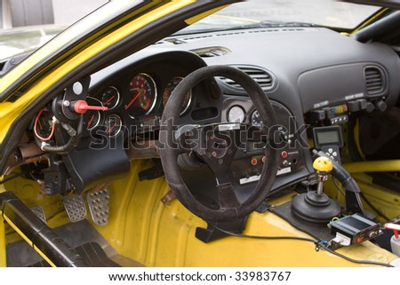 The cockpit of a sports car customized for track racing. - stock photo