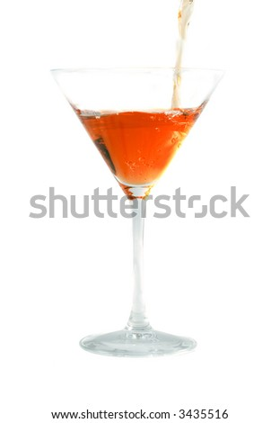 The cocktail flowing into a glass. Isolation on white - stock photo