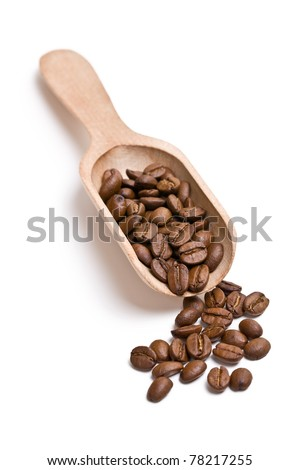 the coffee beans on wooden scoop - stock photo
