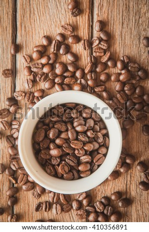 The coffee cup and coffee beans.