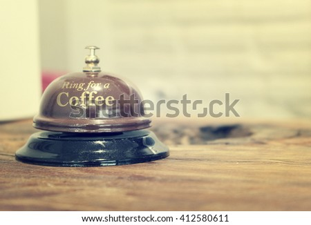 The coffee ringing bell in retro style with selective focus on the word coffee