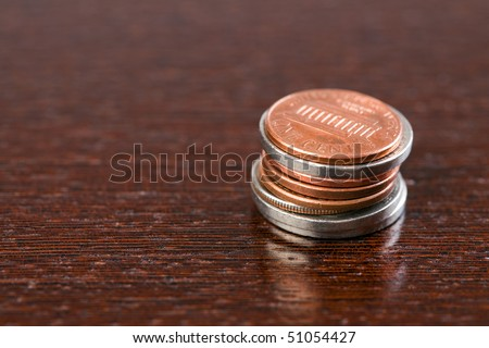 the coins on wooden table