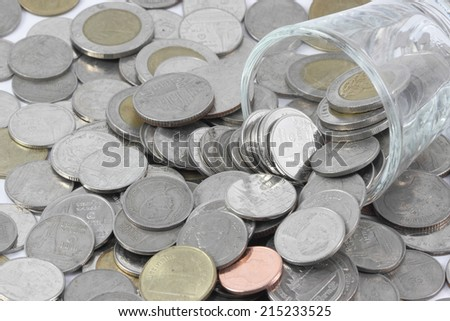 The coins over the glass be comparable to greed of human - stock photo