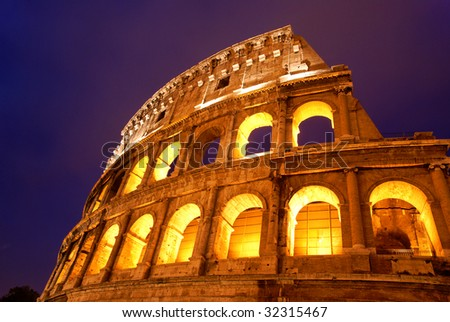 The Coliseum in Rome by night - stock photo