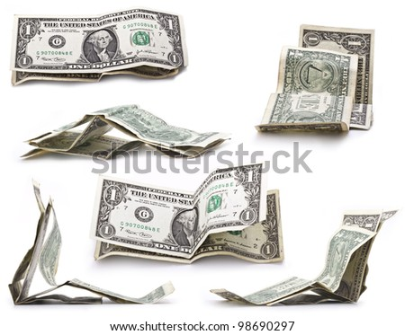 The collection of crumpled one dollar bills
