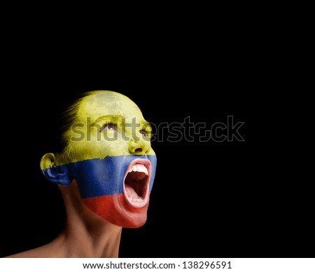 The Colombian flag on the face of a screaming woman. concept - stock photo
