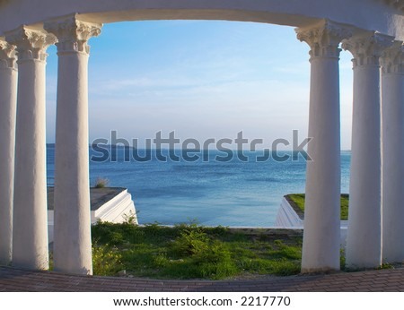 The colonnade framing pass to the sea - stock photo