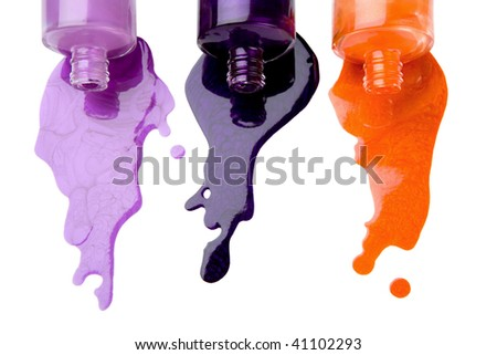 The color nail polish which is pouring out from bottles on a white background - stock photo