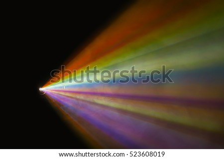 The color projector light beam through smoke and air dust