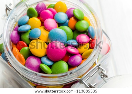 the colored candy in glass jar - stock photo