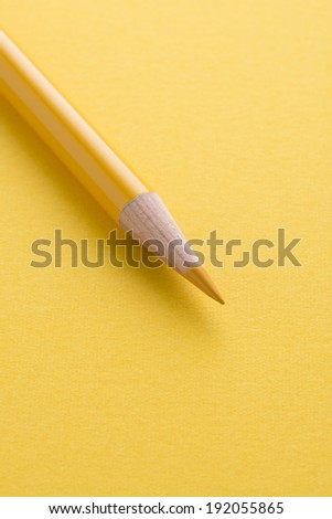 the colored pencil on a yellow background