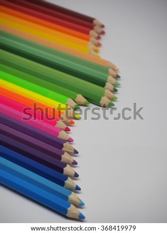 the colored pencils in the bottle and white backgrounds
