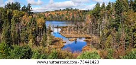 The Colorful Autumn Foliage At Rock Lake Near Ishpeming Michigan In The Upper Peninsula, USA - stock photo