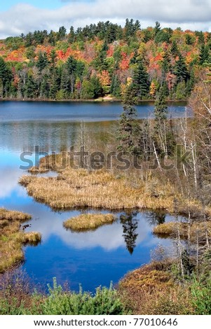 The Colorful Autumn Foliage At Rock Lake Near Ishpeming Michigan In The Upper Peninsula, USA - stock photo