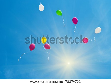 The colorful balloons on the blue sky. Shallow DOF