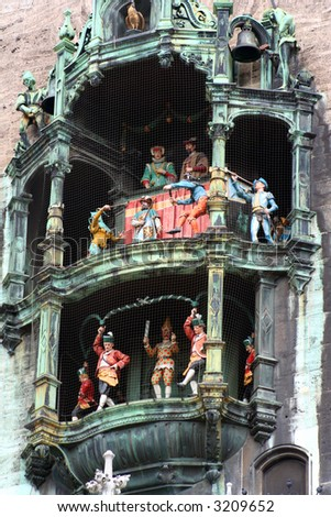 The colorful dolls dancing in the clock of the new town hall building of Marienplatz in Munich, Germany. - stock photo
