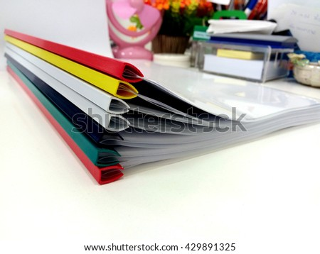 The colorful folders on the table to be used for training.