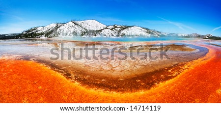 The colorful Grand Prismatic Spring (of Midway Geyser Basin) - Yellowstone National Park. - stock photo